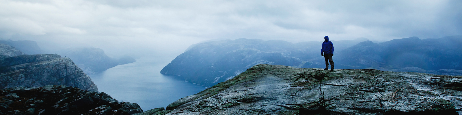 traveler looking on the fjords, hiking in Norway